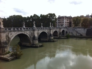 Dirty Rome River and pretty bridge